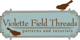 Violette Field Threads Logo
