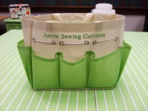 "Arrow Cabinets Canvas Craft & Notions Bag 12x6x8"", 7 Side Pockets, Draw String, Green on White, Embroidered with Arrow Cabinets and Kangaroo Cabinets"