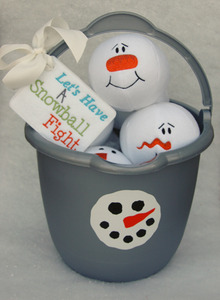 We wrapped a set of snowballs inside of a bucket in cellophane for a gift and it was adorable.