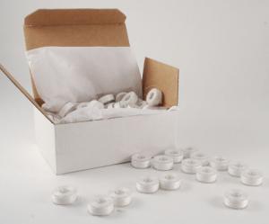 13077: Fil Tec H13078 ClearGlide 100x135Yd Prewound Plastic L Bobbins 60wt Poly Emb Thread White