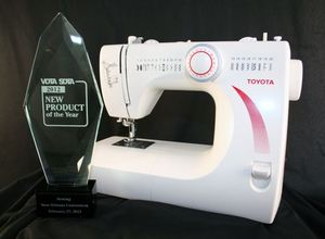 Toyota STF39 20-Stitch Mechanical Sewing Machine, 1-Step Buttonhole, Needle Threader, Metal Casting, Bobbin Case, and Shuttle Hook